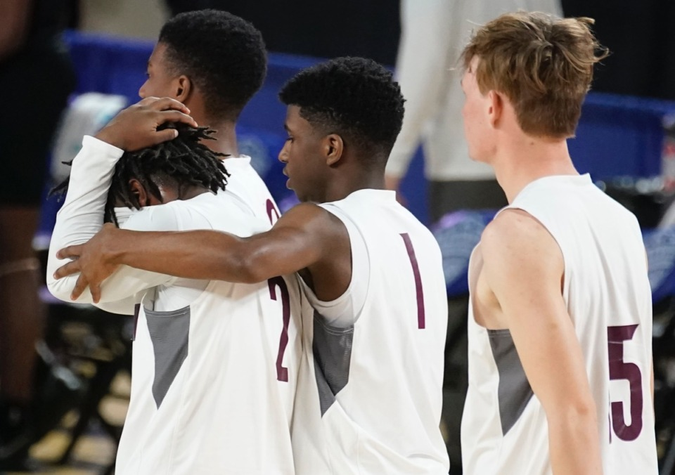 <strong>Collierville guard Terrian McNeal (1) consoles Collierville guard Jordan Coleman (2) after Collierville lost to Cane Ridge on March 19 at Murfreesboro, Tennessee.</strong> (Larry McCormack/Special to The Daily Memphian)