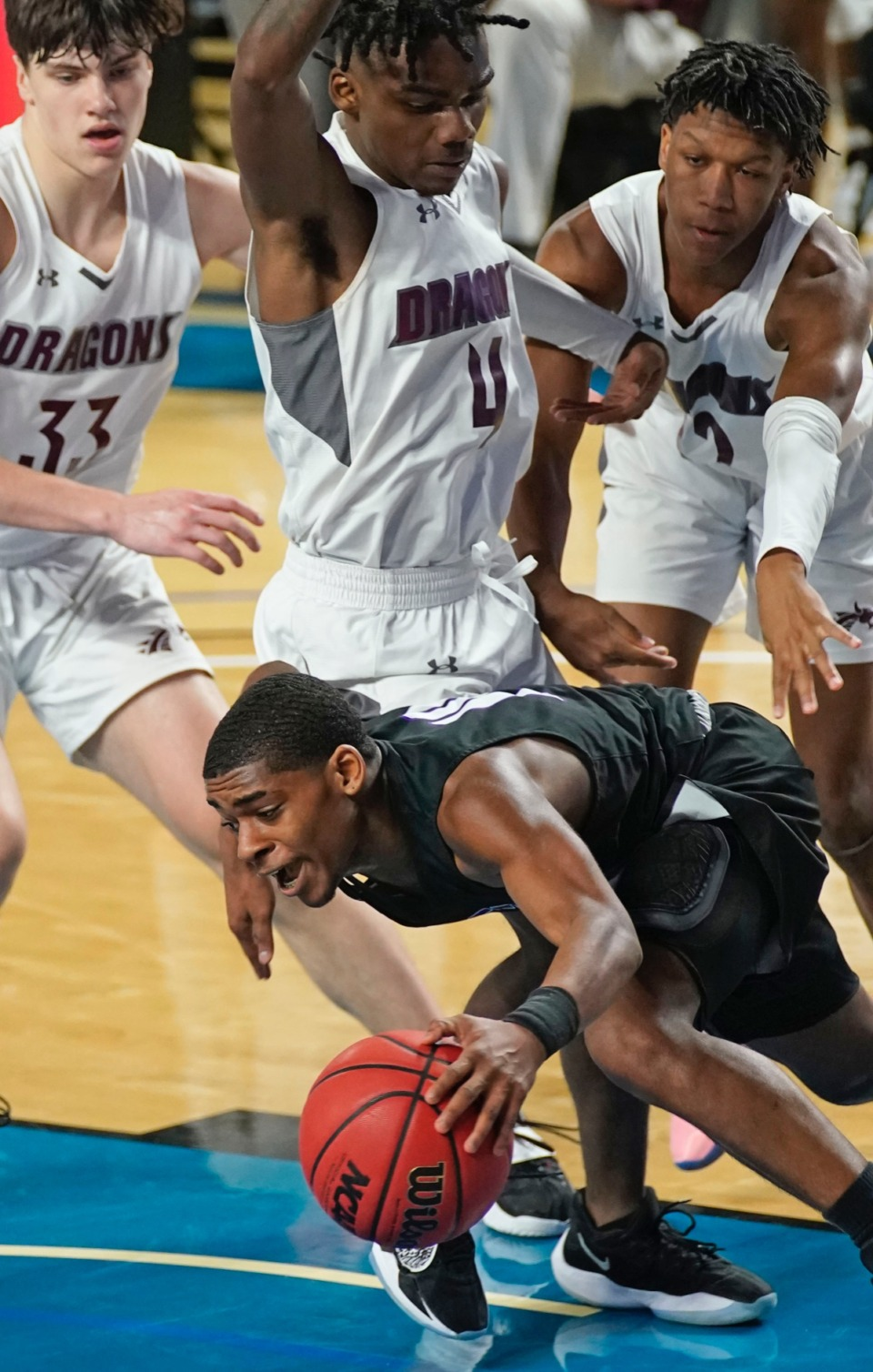 <strong>Cane Ridge&rsquo;s Brandon Miller (24) tries to escape pressure from the Collierville defense&nbsp;on March 19 in Murfreesboro, Tennessee.</strong> (Courtesy Larry McCormack/Special to The Daily Memphian)