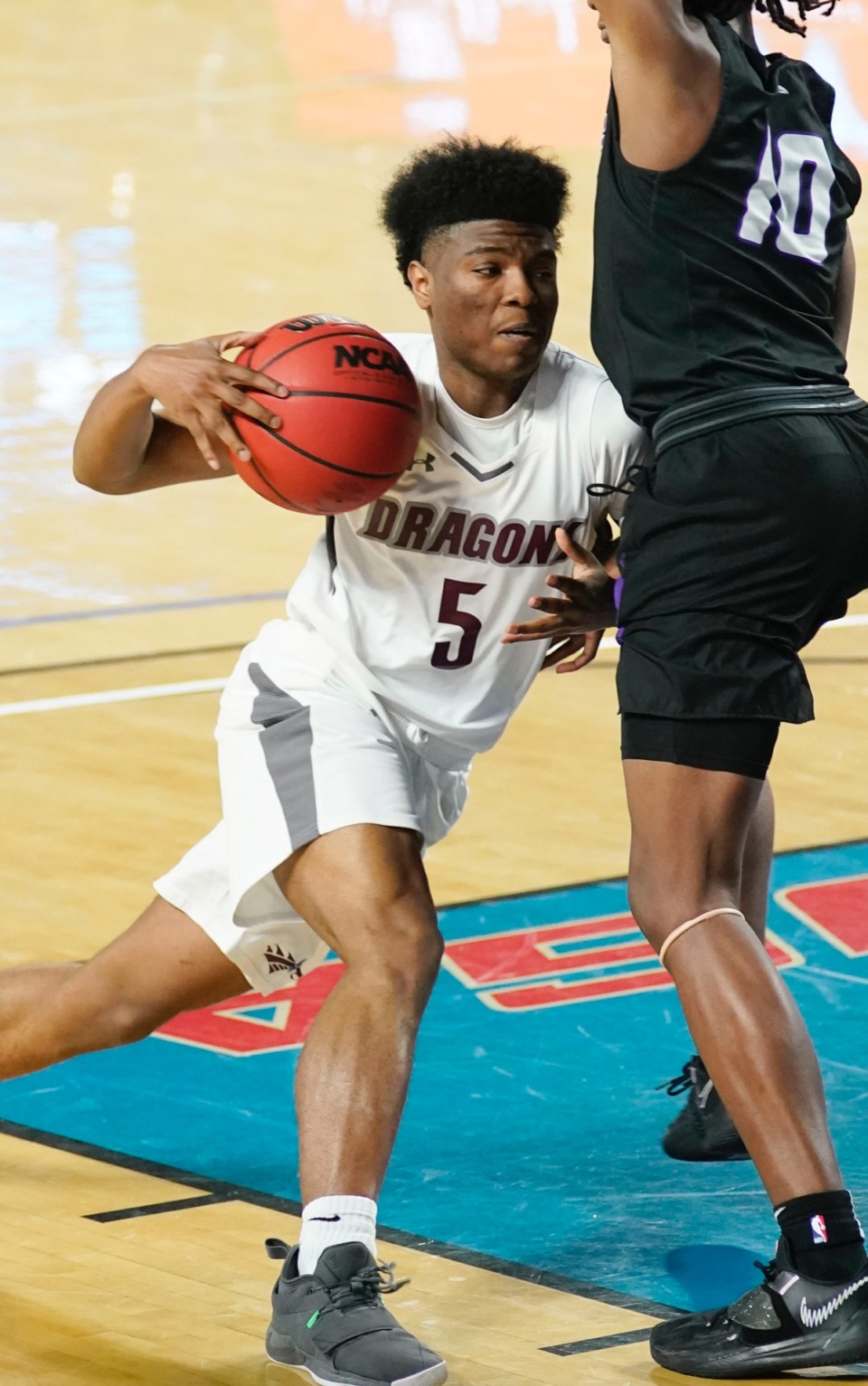 <strong>Collierville guard Danny Perry (5) tries to make his own lane as Collierville plays Cane Ridge&nbsp;on March 19 in Murfreesboro, Tennessee.</strong> (Courtesy Larry McCormack/Special to The Daily Memphian)