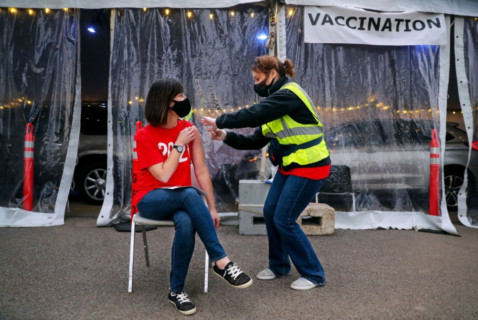 <strong>Elissa Stratton, executive director of human resources for Germantown Schools, receives a COVID-19 vaccine from registered nurse Alison Herrington at Germantown Baptist Church on March 5. The number of doses administered has more than doubled since the City of Memphis took over vaccine distribution from the Shelby County Health Department.</strong> (Patrick Lantrip/Daily Memphian)