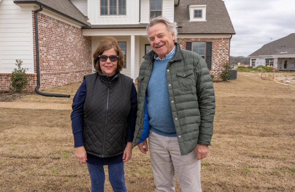 <strong>David Goodwin of David Goodwin Homes stands in front of one of his spec homes with partner and CEO Susan Payne in the Belmont subdivision in Arlington Friday, March 19. Goodwin, in partnership with Creekside Homes, just received permission from the Arlington Planning Commission to complete phase 3 of the subdivision.</strong> (Greg Campbell/Special to the Daily Memphian)