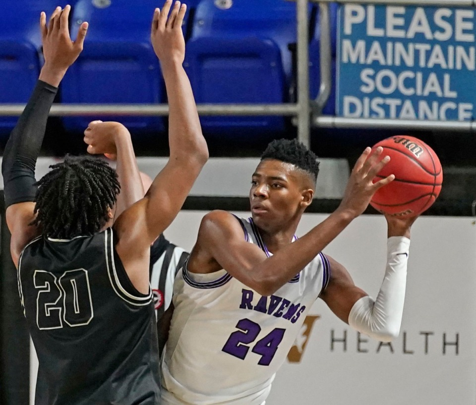 <strong>Houston guard Antonio Madlock (20) defends against Cane Ridge&rsquo;s Brandon Miller (24).</strong> (Larry McCormack/Special to the Daily Memphian)