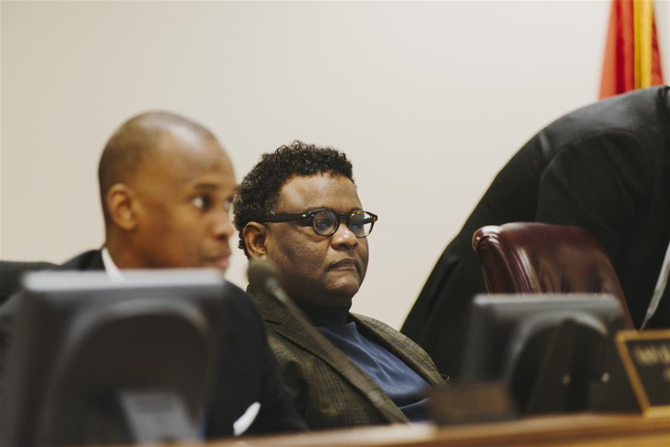 """<p class=""""p1""""><strong>Assessor Melvin Burgess Jr. listens during a County Commission meeting in 2018. Burgess is proposing a change from property reappraisals every four years to a reappraisal every other year.</strong> (Houston Cofield/Daily Memphian file)"""