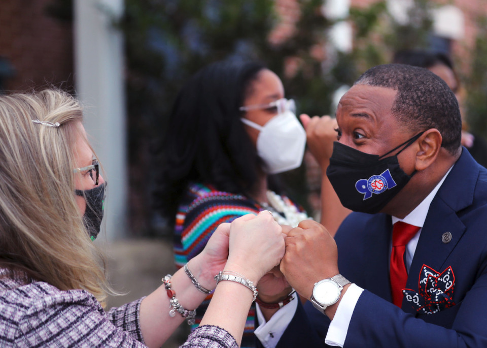 <strong>SCS Superintendent Joris Ray fist-bumps a Riverwood Elementary teacher during a March 1, 2021 visit.</strong> (Patrick Lantrip/Daily Memphian file)