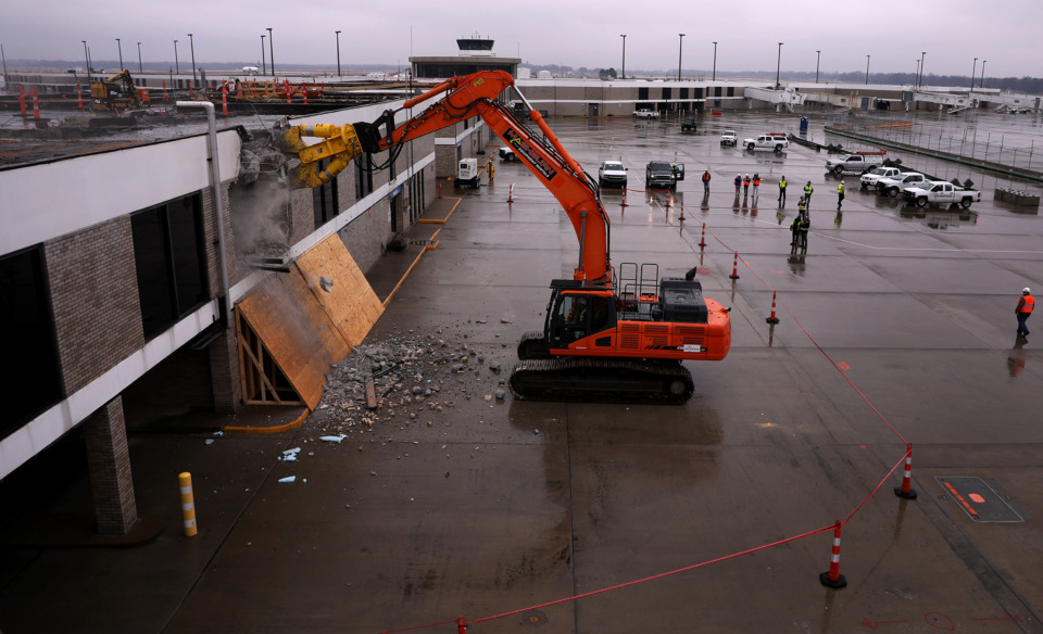 <strong>Crew members from Flintco watch as one of their co-workers tears down a section of Concourse B to make way for Memphis International Airport&rsquo;s modernization efforts on Thursday, Jan. 17, 2019.</strong> (Patrick Lantrip/Daily Memphian.)