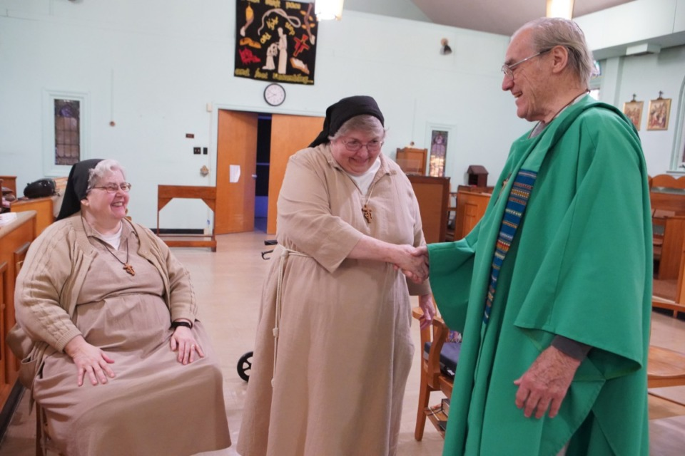 <strong>Father David Knight celebrates with the Poor Clare&rsquo;s of Memphis one of their last masses together in the private chapel on Nov. 20, 2019. This was shortly before the Monastery of St. Clare closed at the end of 2019.</strong> (Karen Pulfer Focht/Special to The Daily Memphian)