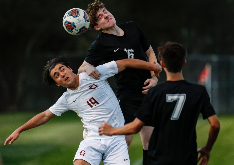 <strong>St. George&rsquo;s midfielder Diego Guerra (bottom) battles Houston defender Cage Warmth (top) for a loose ball on Tuesday, March 23, 2021.</strong> (Mark Weber/The Daily Memphian)