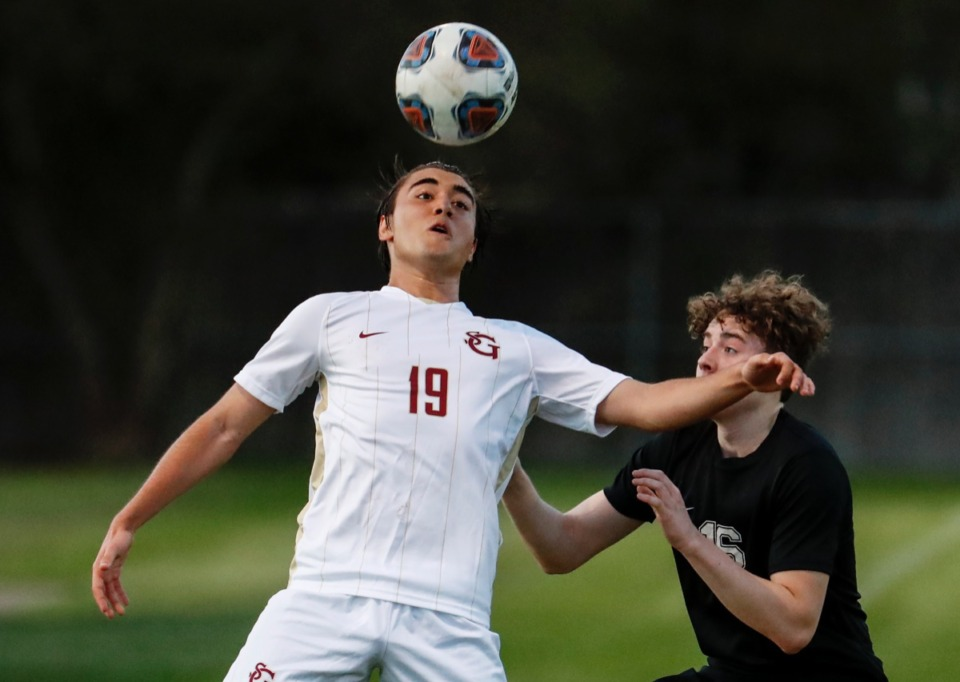 <strong>St. George&rsquo;s midfielder Diego Guerra (left) battles Houston defender Cage Warmth (right) for a loose ball on Tuesday, March 23, 2021.</strong> (Mark Weber/The Daily Memphian)