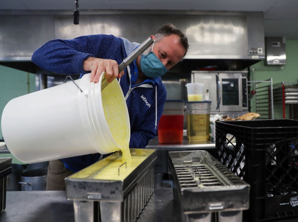 <strong>Chris Taylor pours a batch of banana pineapple pops into the molds at MemPops' central kitchen March 23, 2021.</strong> (Patrick Lantrip/Daily Memphian)