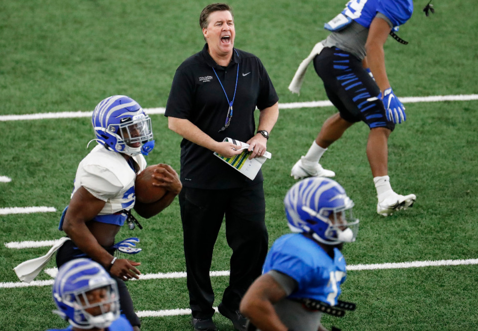 <strong>Memphis defensive coordinator Mike MacIntyre (middle) during practice on Tuesday, March 23, 2021.&nbsp;Memphis finished No. 8 in total defense in the AAC last year, but looks to improve this season. </strong>(Mark Weber/The Daily Memphian)