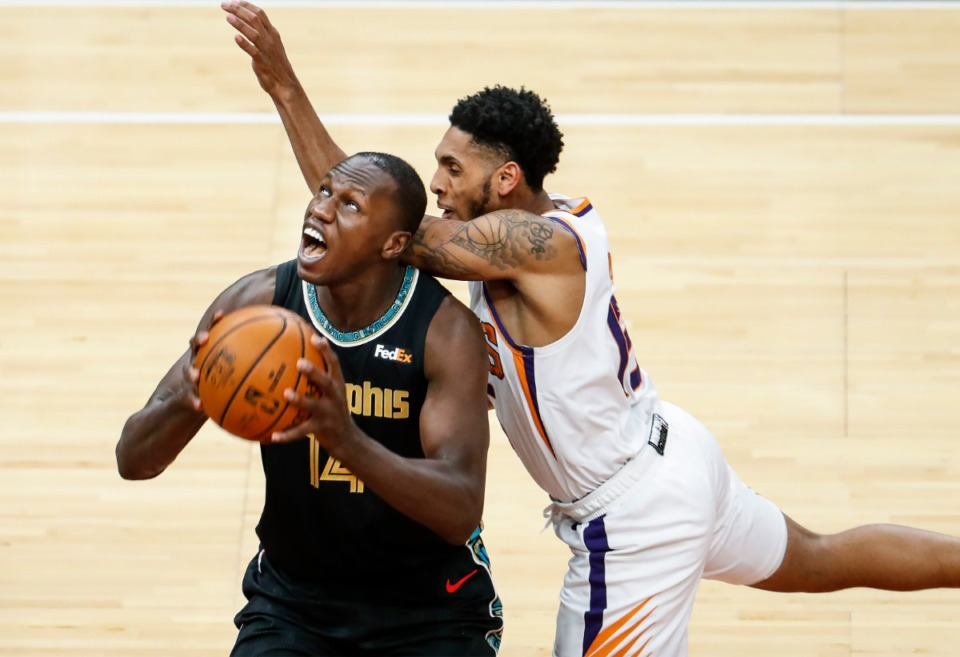 <strong>Memphis Grizzlies center Gorgui Dieng (left) is fouled by Phoenix Suns defender Cameron Payne (right) during action on Monday, January 18, 2021.</strong> (Mark Weber/The Daily Memphian)
