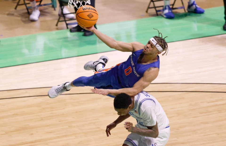 <strong>Boise State guard Marcus Shaver Jr., top, goes for a layup and collides with Memphis forward D.J. Jeffries</strong>&nbsp;<strong>on March 25 in Denton, Texas.</strong> (Ron Jenkins/AP)