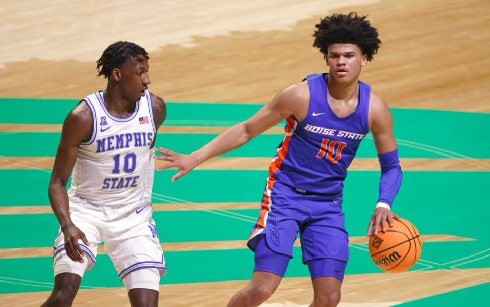 <strong>Boise State guard RayJ Dennis (10) drives against Memphis guard Damion Baugh (10) on March 25 in Denton, Texas.</strong> (Ron Jenkins/AP)