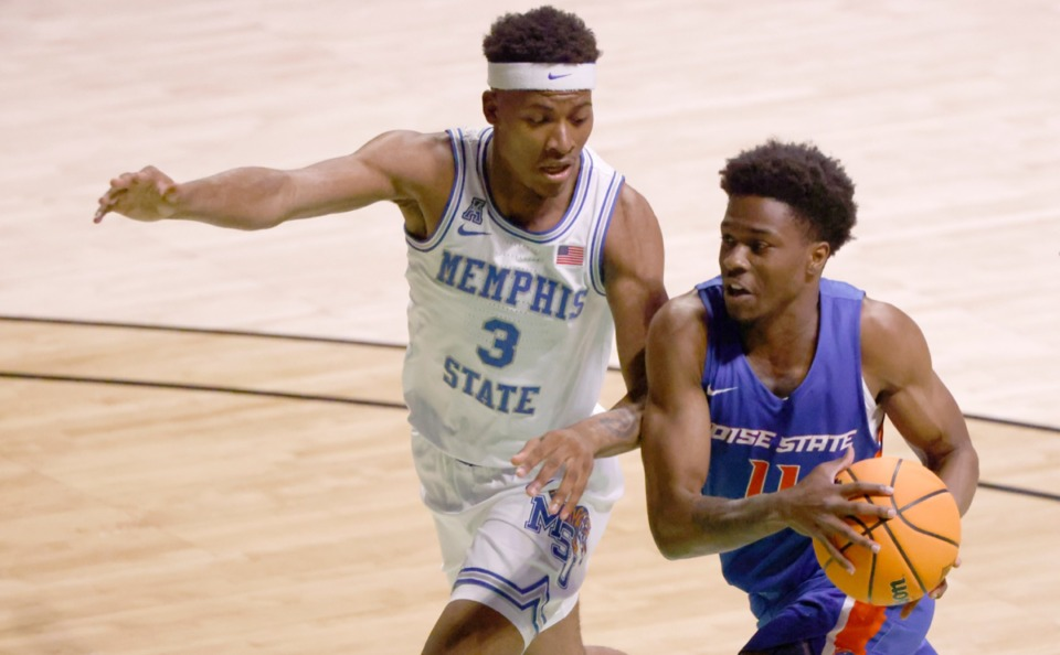 <strong>Boise State guard Devonaire Doutrive (11) drives against Memphis guard Landers Nolley II (3) in the NIT on March 25 in Denton, Texas.</strong> (AP Photo/Ron Jenkins)