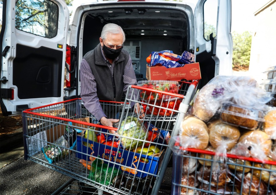 <strong>Resource Redistribution Ministry volunteer Jerry Burch loads his van with produce and other food donated by Costco on Wednesday, March 24, to be delivered to&nbsp; First United Methodist Church Downtown.</strong> (Mark Weber/Daily Memphian)