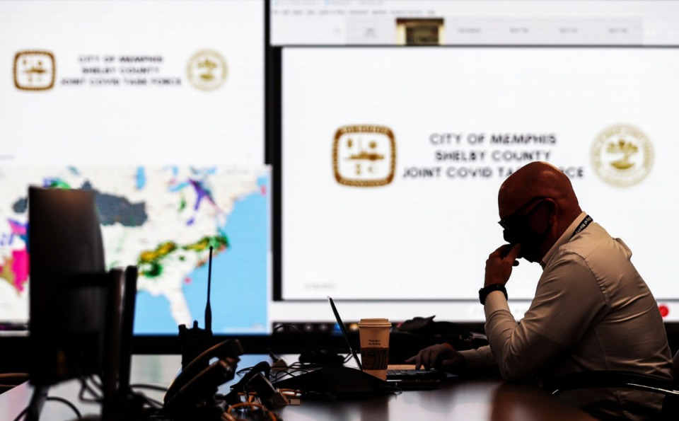 <strong>City of Memphis chief operating officer Doug McGowan looks over his notes shortly before a meeting of the COVID task force at the Office of Emergency Management March 16, 2021. </strong>(Patrick Lantrip/Daily Memphian)