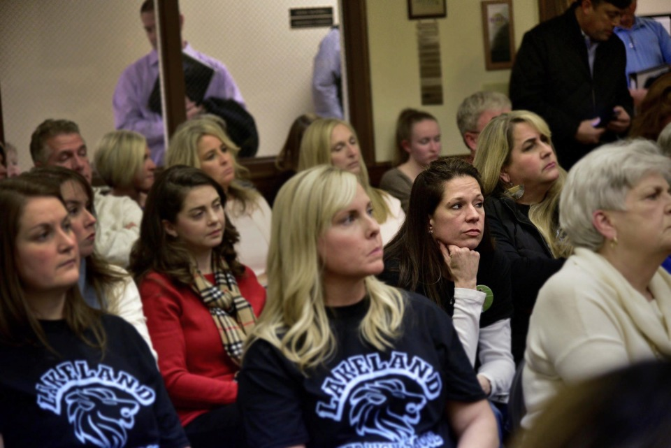 <strong>Lakeland resident Katie Autry (center right) listens as the Lakeland Board of Commissioners presents information on funding for a new high school Thursday, Jan. 17, 2019. Autry, a mother of three, joined an overflow crowd on Monday evening at the special-called meeting of the town's Board of Commissioners to consider funding for a new high school.</strong> (Stan Carroll/Special to The Daily Memphian)