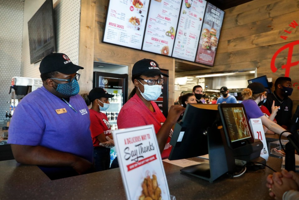 <strong>Severs take customers&rsquo; orders at the new Slim Chickens restaurant in Collierville on Friday, March 26.</strong> (Mark Weber/The Daily Memphian)