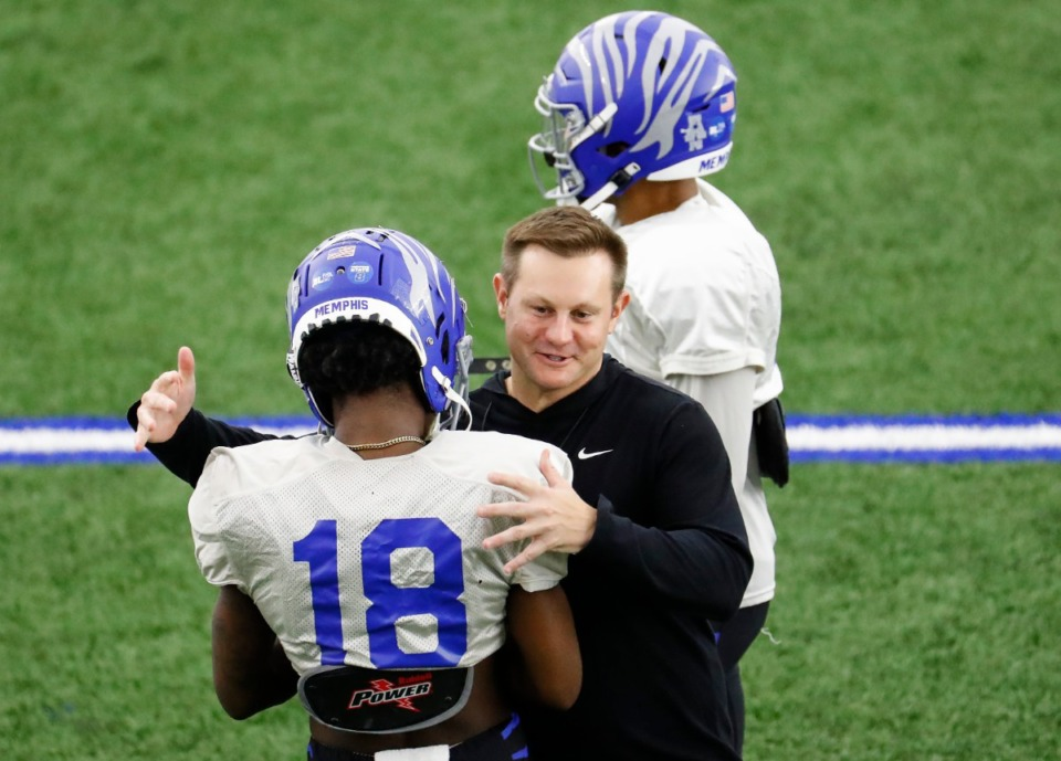 <strong>Memphis head coach Ryan Silverfield (right) hugs Tahj Washington (left) during practice on March 23. Washington says Silverfield offered &ldquo;nothing promising&rdquo; and the receiver has entered the transfer portal.</strong> (Mark Weber/The Daily Memphian file)