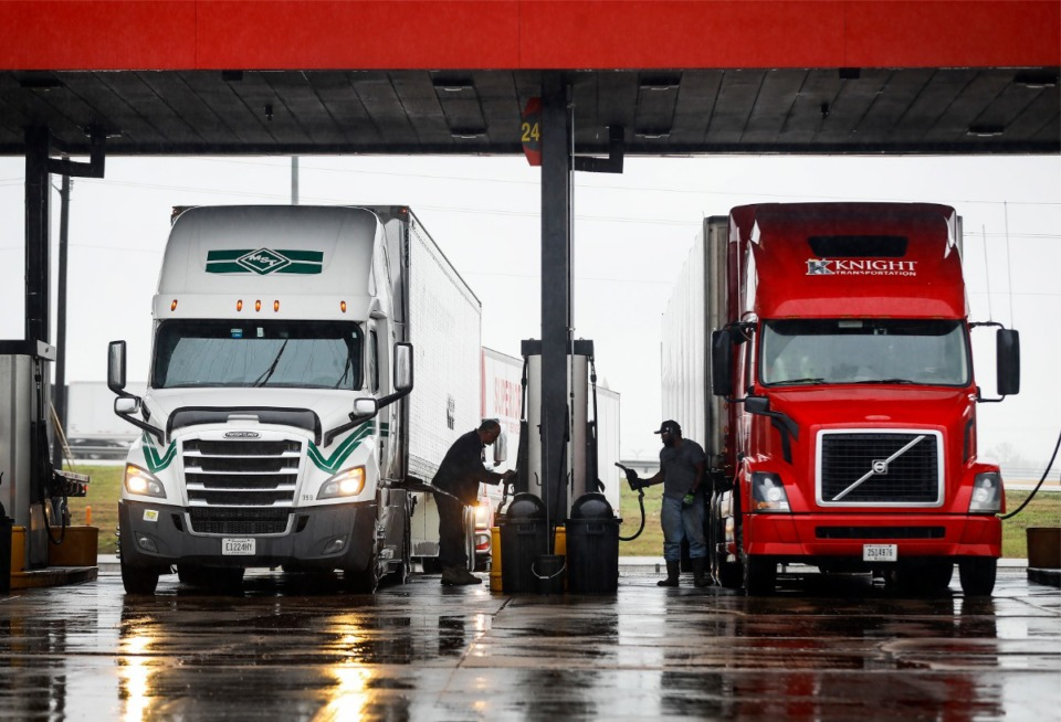 <strong>Truck drivers fill their tanks on Thursday, March 25, in West Memphis. Rising gas prices have affected transportation, shipping and logistics companies.</strong> (Mark Weber/Daily Memphian)