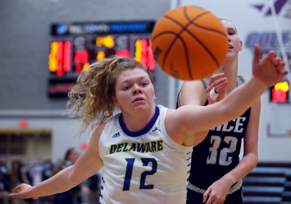 <strong>University of Delaware forward Lizzie O' Leary (12) fights for a rebound against Rice University center Nancy Mulkey (32)&nbsp;in a WNIT game</strong>&nbsp;<strong>at Collierville High School in Collierville on March 26.</strong> (Patrick Lantrip/Daily Memphian)