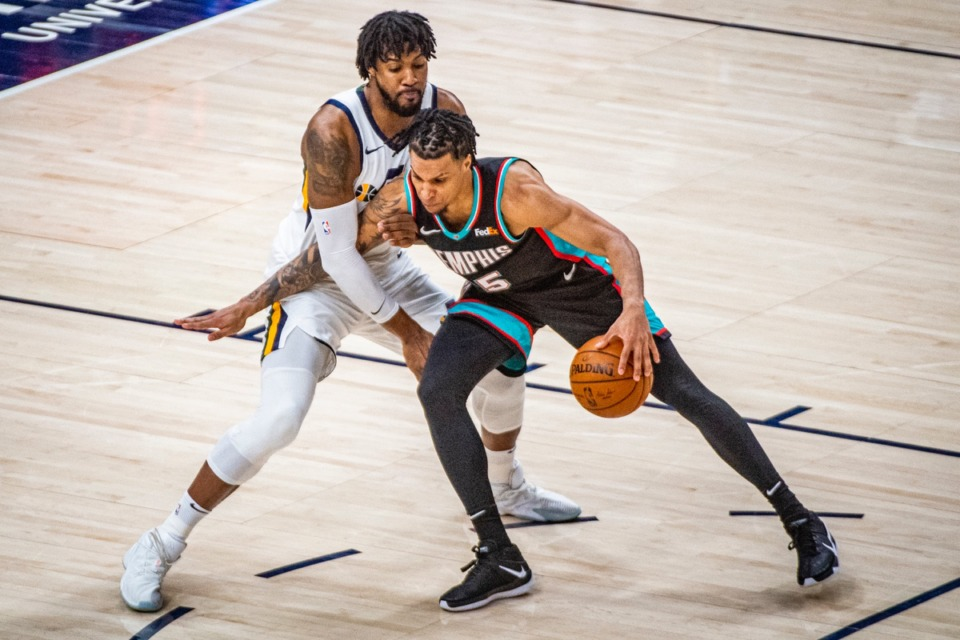<strong>Grizzlies forward Brandon Clarke, right, charges Utah Jazz center Derrick Favors, left, on March 26, in Salt Lake City.</strong> (Isaac Hale/AP)