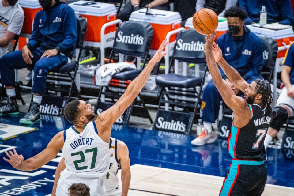 <strong>Grizzlies forward Justise Winslow (7) shoots over Utah Jazz center Rudy Gobert (27)</strong>&nbsp;<strong>on March 26, in Salt Lake City.</strong> (Isaac Hale/AP)