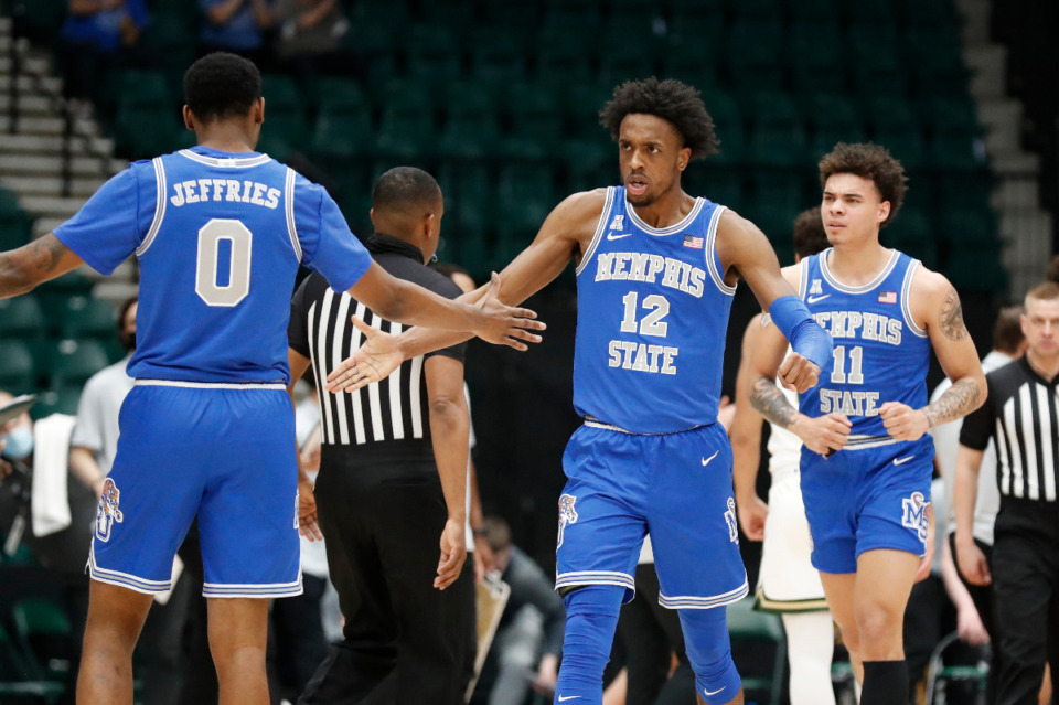<strong>Memphis forward D.J. Jeffries (0) congratulates DeAndre Williams (12) during the Tigers NIT semifinal victory against Colorado State, Saturday, March 27 in&nbsp; Frisco, Texas.</strong> (Photo courtesy of the NCAA)