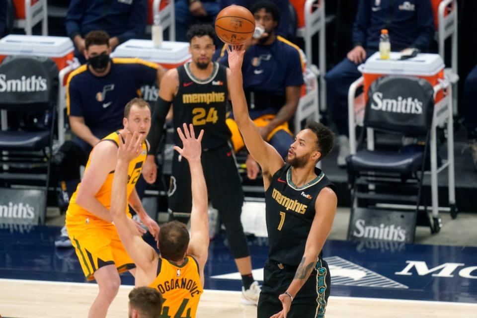 <strong>Memphis Grizzlies forward Kyle Anderson (1) shoots as Utah Jazz forward Bojan Bogdanovic (left), defends during an NBA basketball game Saturday, March 27, 2021, in Salt Lake City.</strong> (AP Photo/Rick Bowmer)