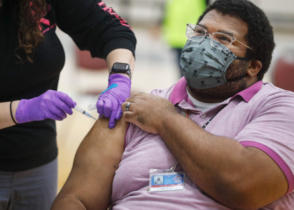 <strong>Kyle Wright receives a vaccine shot during Arlington High School&rsquo;s vaccination event on Friday, March 26, 2021. Municipal and school employees from Arlington, Millington and Lakeland were able to receive the vaccine.</strong> (Mark Weber/The Daily Memphian)