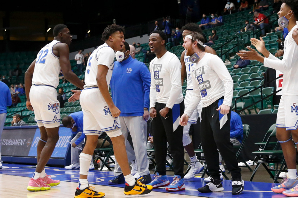 <strong>The Memphis team celebrates during Sunday&rsquo;s NIT championship game against Mississippi State.</strong> <strong>The Tigers pulled away in the second half to win 77-64.</strong> (Photo courtesy of the NCAA)