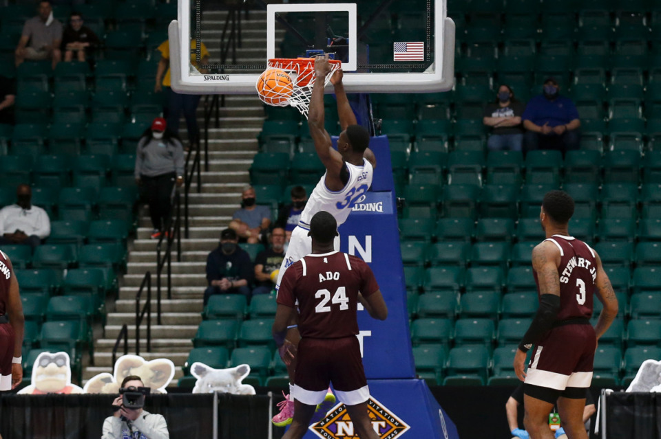 <strong>Memphis center Moussa Cisse dunks against Mississippi State during Sunday&rsquo;s NIT championship game in Frisco, Texas.</strong> (Photo courtesy of the NCAA)
