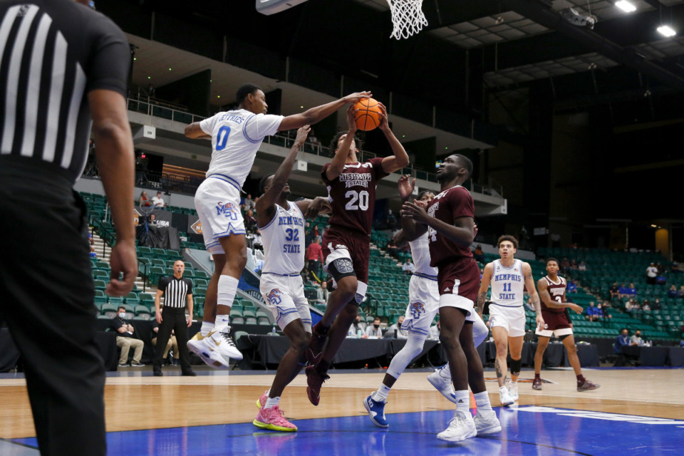 <strong>Memphis forward D.J. Jeffries blocks Mississippi State forward Derek Fountain&rsquo;s shot during Sunday&rsquo;s NIT championship game in Frisco, Texas.</strong> (Photo courtesy of the NCAA)