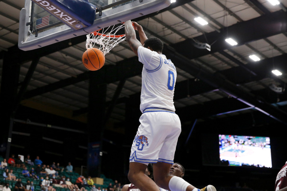 <strong>Memphis forward D.J. Jeffries dunks against Mississippi State during Sunday&rsquo;s NIT championship game in Frisco, Texas.</strong> (Photo courtesy of the NCAA)