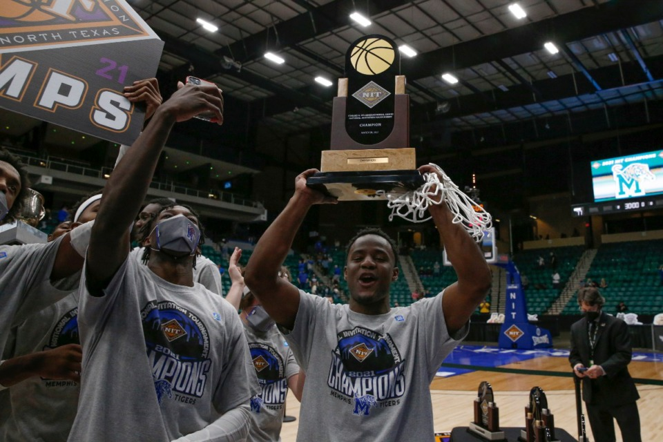 <strong>&ldquo;Just being out there, it just meant the world to me,&rdquo; said Tigers basketball guard Alex Lomax (right). He hoisted the NIT trophy and a piece of the basketball net while celebrating with guard Damion Baugh Sunday, March 28, 2021.</strong> (Courtesy NCAA)