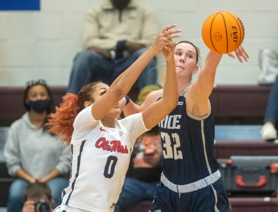 <strong>Nancy Mulkey (32) of Rice University bats away a pass to the inside for Ole Miss' Shakira Austin (0) during the finals of the WNIT at My Town Movers Fieldhouse in Collierville, Sunday, March 28, 2021.</strong> (Greg Campbell/Special to The Daily Memphian)