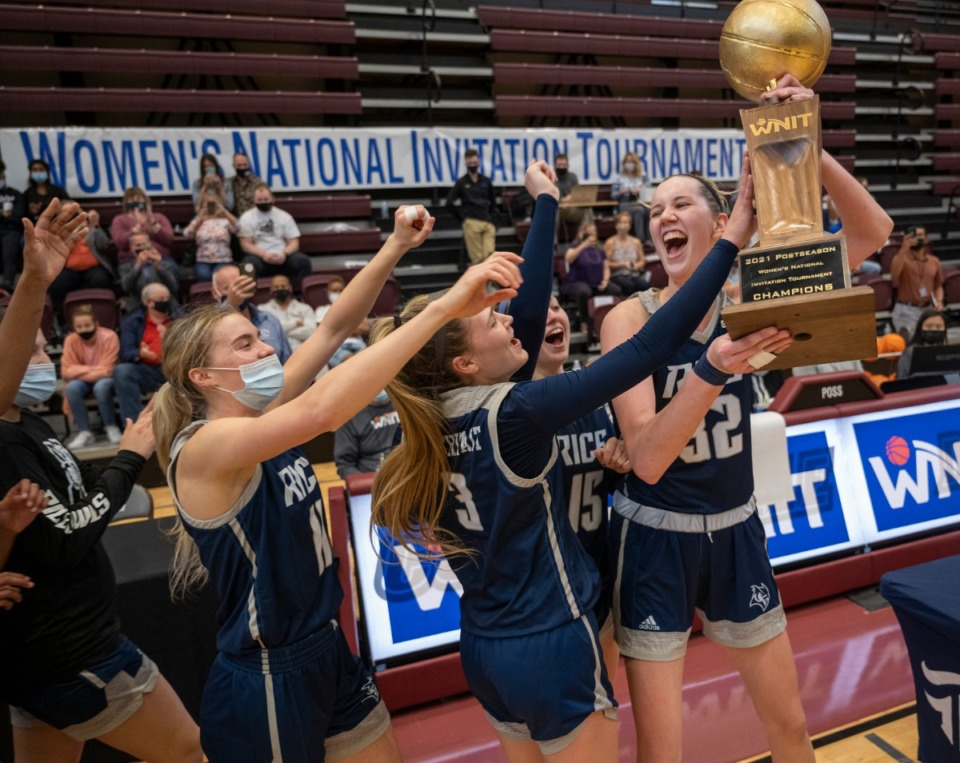<strong>Nancy Mulkey of Rice University hoists the WNIT trophy at the finals in Collierville, Sunday, March 28, 2021. Rice defeated the Ole Miss Rebels, 71-58.</strong> (Greg Campbell/Special to The Daily Memphian)