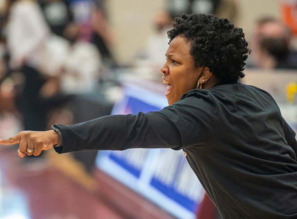<strong>Ole Miss Women's basketball coach, Yolett McPhee-McCuin yells out instructions to her squad during the finals of the WNIT Sunday, March 28, 2021. McPhee-McCuin had missed all but the semi and finals due to COVID-19.</strong> (Greg Campbell/Special to The Daily Memphian)