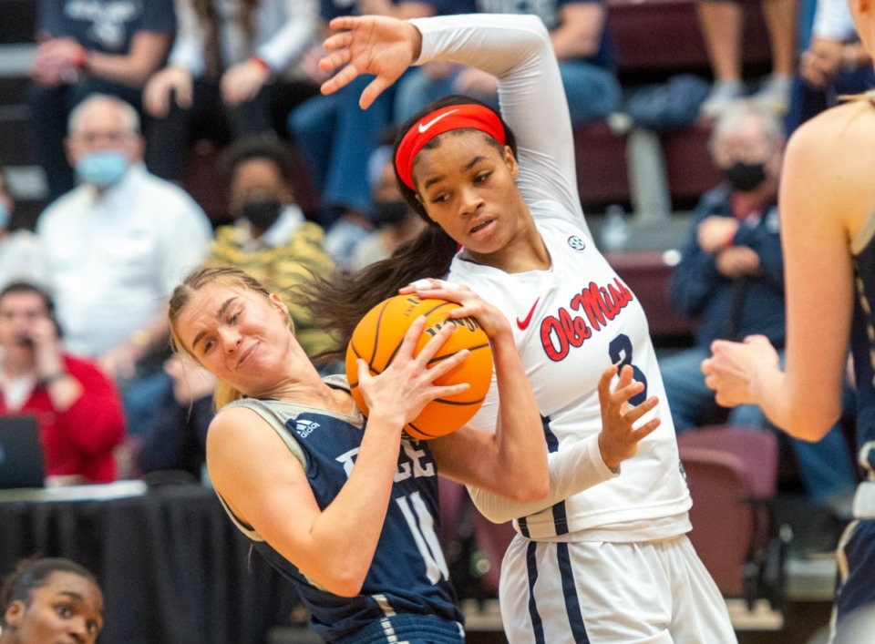 <strong>Rice University's Haylee Swazye (11) fights for a loose ball with Ole Miss' Donnetta Johnson (3) duing the WNIT finals in Collierville. Rice defeated Ole Miss 71-58.</strong> (Greg Campbell/Special to The Daily Memphian)