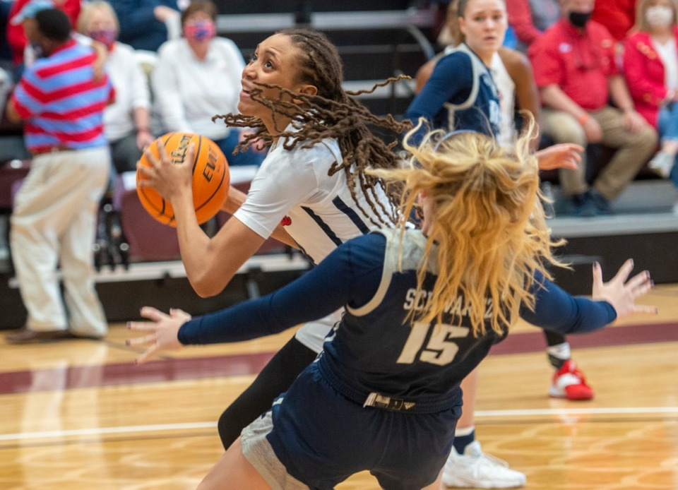 <strong>Ole Miss forward Madison Scott drives to the basket as Rice University's Lauren Schwartz (15) tries to draw a charge during the WNIT finals at My Home Town Movers Fieldhouse in Colliervillle.</strong> (Greg Campbell/Special to The Daily Memphian)