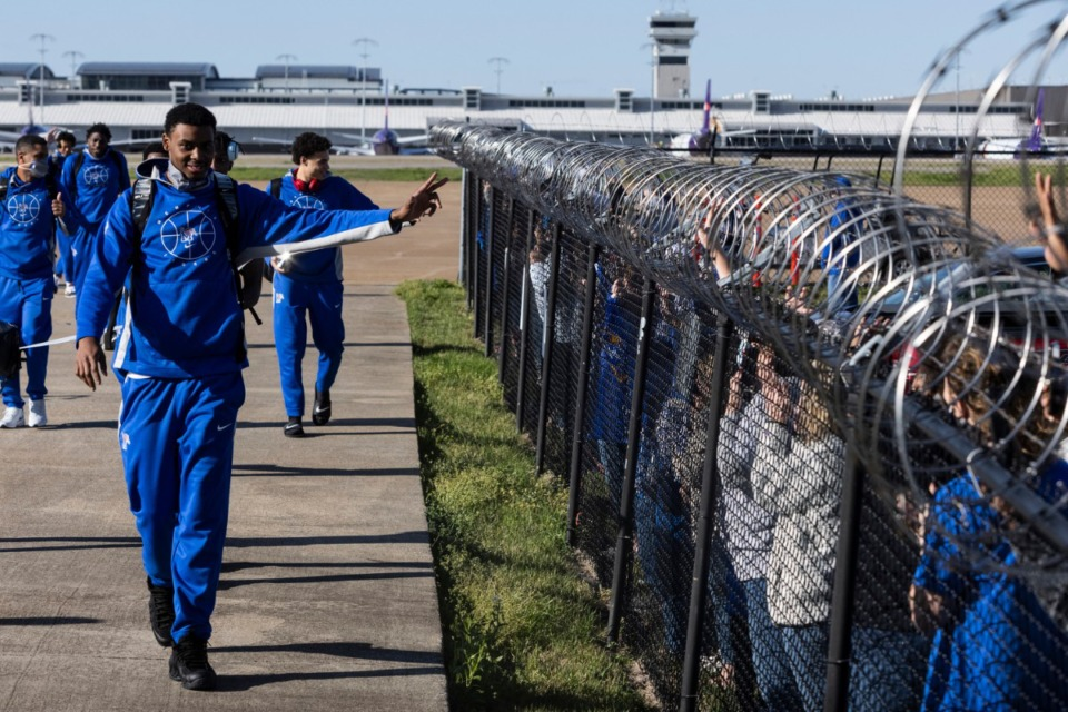 <strong>University of Memphis basketball players arrive to a heroes&rsquo; welcome at Wilson Air as they return from Frisco, Texas, where they won the National Invitation Tournament Sunday, March 28, 2021.</strong> (Brad Vest/Special to The Daily Memphian)