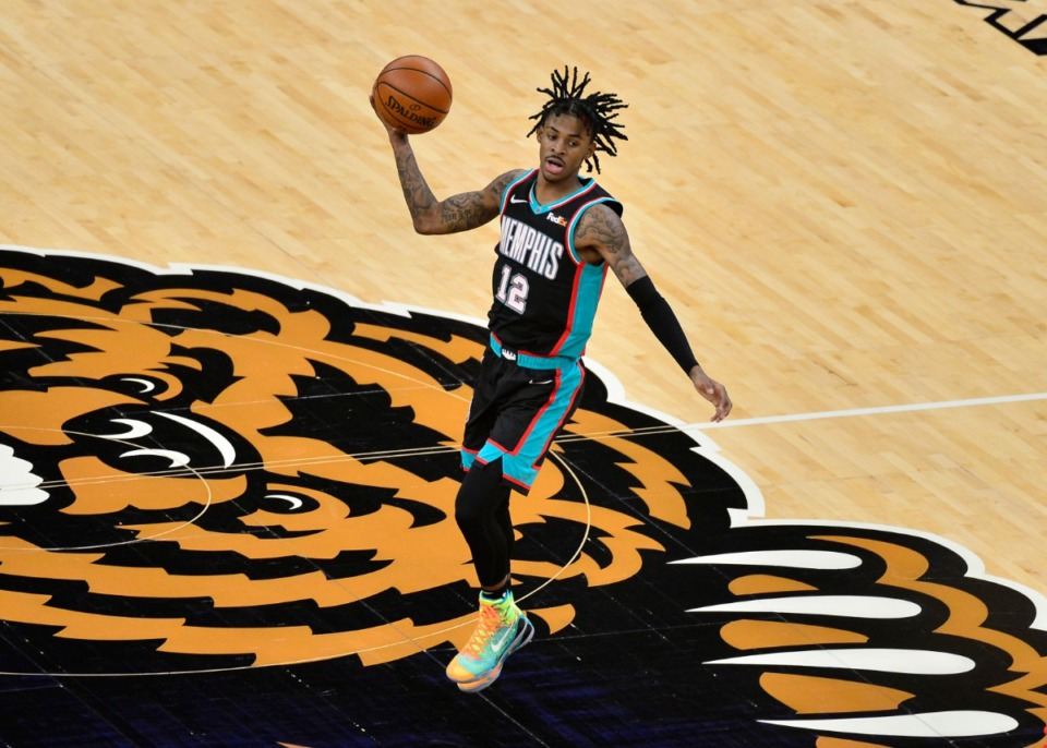 <strong>Memphis Grizzlies guard Ja Morant (12) plays in the first half of an NBA basketball game against the Houston Rockets Thursday, Feb. 4, 2021, at FedExForum.</strong> (Brandon Dill/AP)