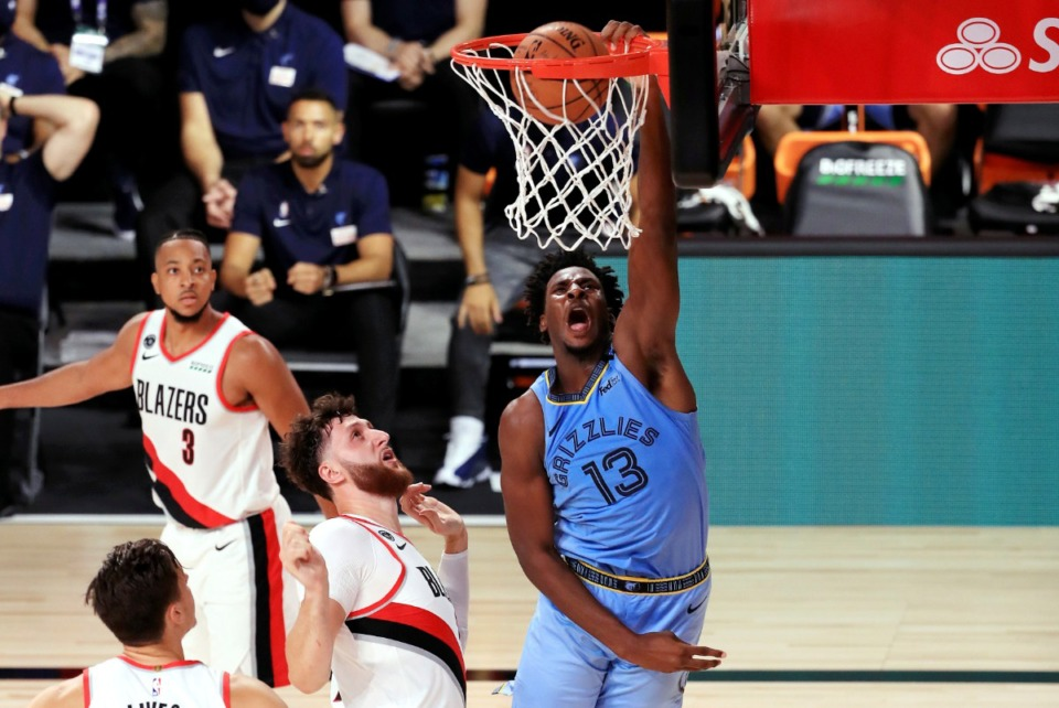 <strong>Memphis Grizzlies' Jaren Jackson Jr. dunks the ball against the Portland Trail Blazers, July 31, 2020, in Lake Buena Vista, Fla. Jackson is expected to return to the court in late April.</strong> (Mike Ehrmann/Pool Photo via AP file)