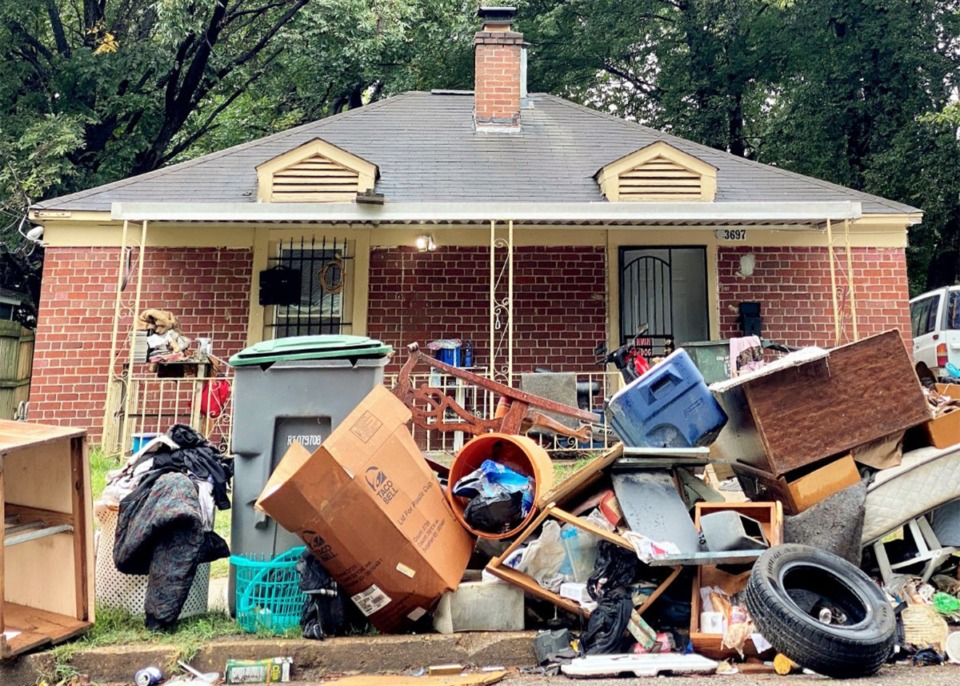 <strong>Personal belongings are piled outside a&nbsp;house on Townes Avenue, near National Cemetery.</strong> (Tom Bailey/Daily Memphian file)