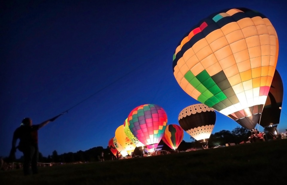<strong>A teammember helps keep a hot air balloon tethered to the ground during the Spirit of Boise Balloon Classic nighttime glow show on Aug. 30, 2019, in Boise, Idaho. The Bluff City Balloon Jamboree will be held in Collierville on Father&rsquo;s Day weekend, June 19-20. The event will include an after-sunset glow show.</strong> (Jim Weber/Daily Memphian file)