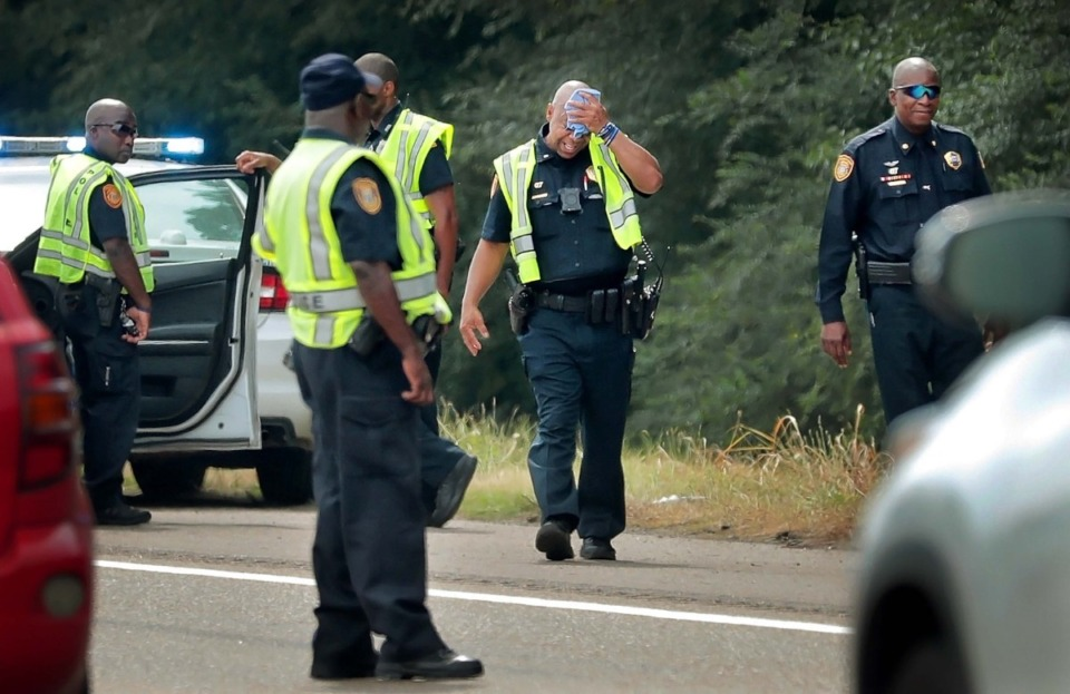 <strong>Memphis police officers work the scene of a shooting at I-240 between Lamar and Millbranch on July 10, 2019.</strong> (Daily Memphian file)