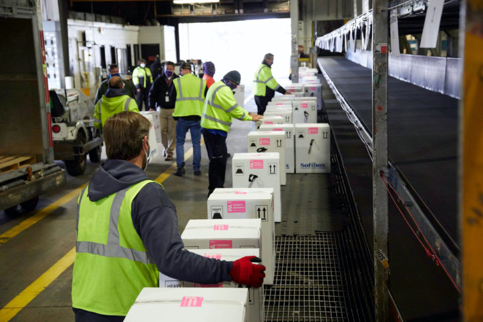 <strong>Workers at the FedEx Express world hub in Memphis handle packages of COVID-19 vaccine during sorting on Sunday, Dec. 13.</strong> (Courtesy FedEx)