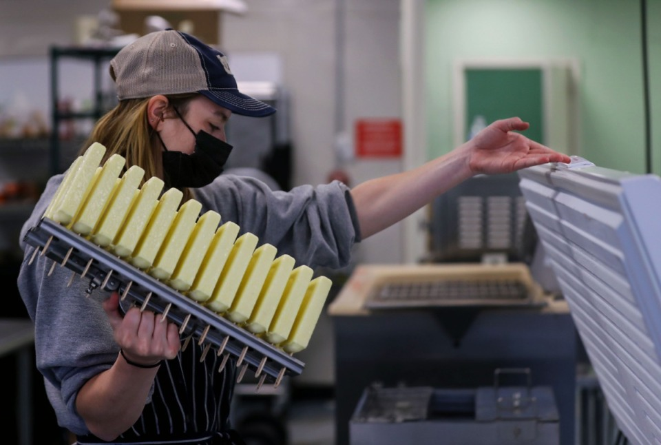 <strong>Allese Lewis loads up a batch of banana pineapple popsicles into the freezer at MemPops' central kitchen on March 23.&nbsp;The Memphis frozen pop business celebrated its fifth anniversary last&nbsp; weekend.</strong> (Patrick Lantrip/Daily Memphian)