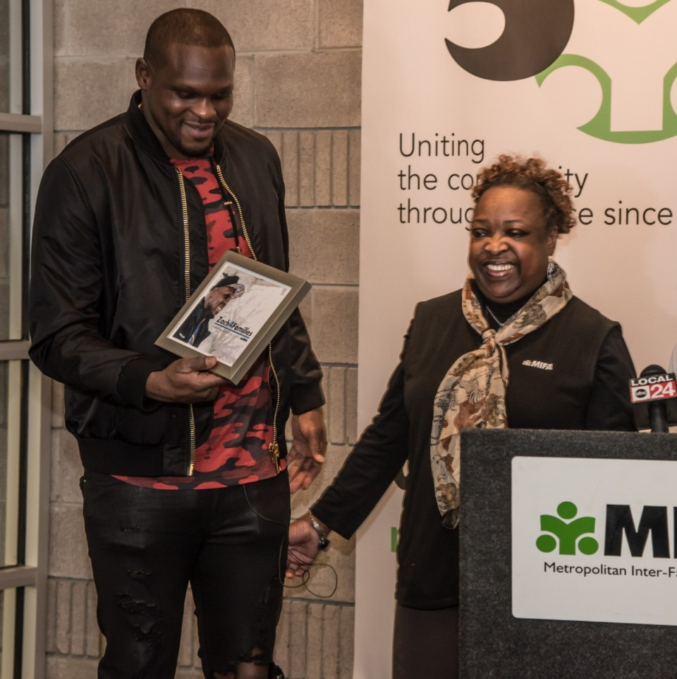 <strong>Phyllis Phillips (right) poses with Zach Randolph during a check presentation at MIFA several years ago. Phillips worked at Metropolitan Inter-Faith Association for 33 years when she died in February at the age of 59.</strong> (Courtesy MIFA)