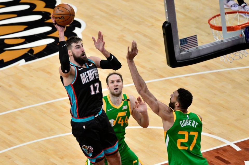 <strong>Grizzlies center Jonas Valanciunas (17) shoots over Utah Jazz center Rudy Gobert (27) and forward Bojan Bogdanovic (44) on March 31 at FedExForum.</strong> (Brandon Dill/AP)